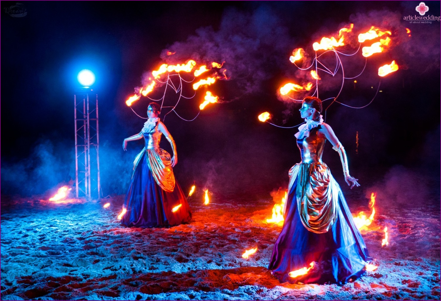 Fire show at a wedding in the style of masquerade