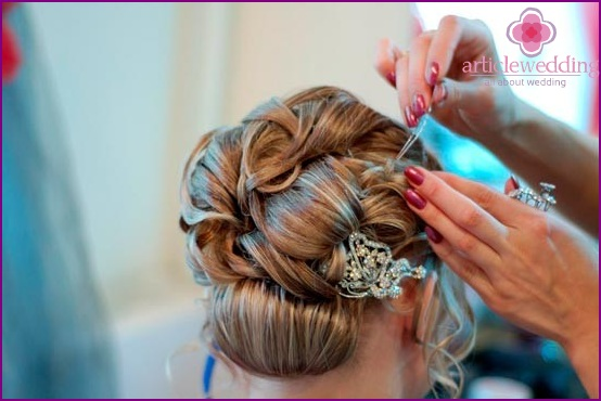 Wedding stylist prepares the bride