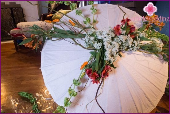 Ready umbrella with flowers and greenery