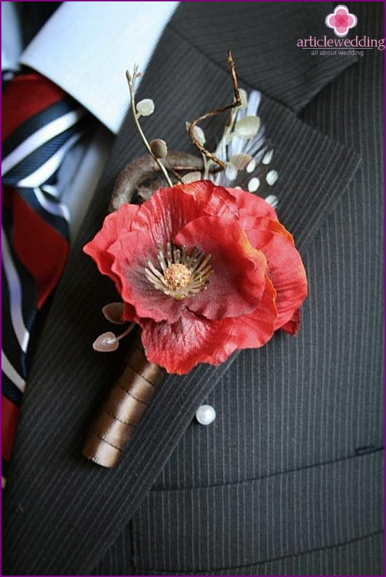 The groom with a buttonhole of poppy