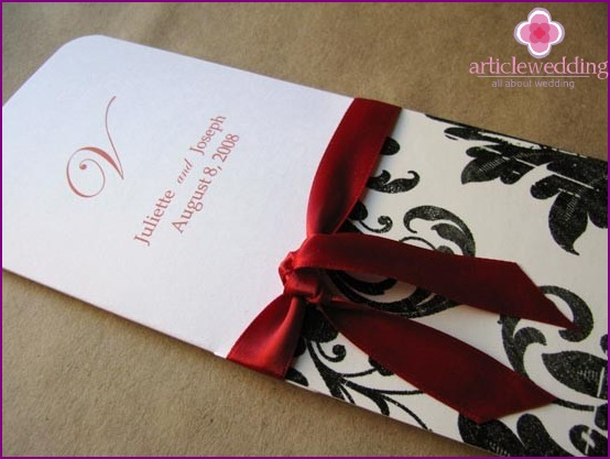 wedding program, tied with ribbon