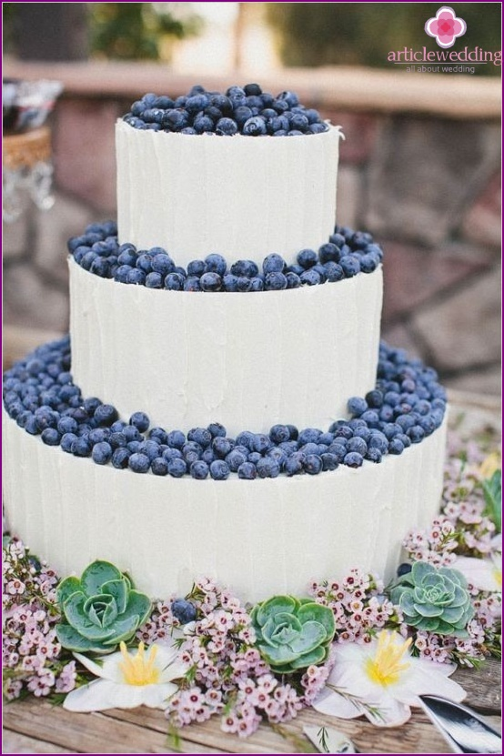 The multi-tiered cake with blueberries