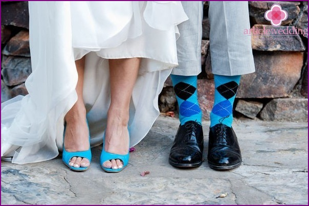 the bride and groom wear turquoise sandals