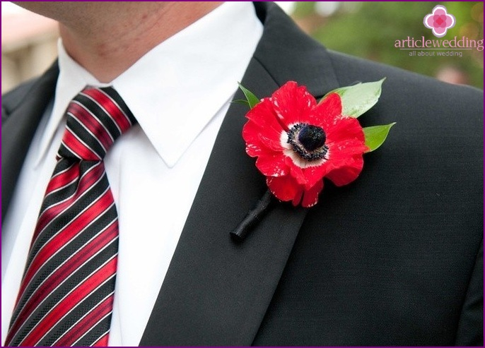 Bright boutonniere of poppy own hands