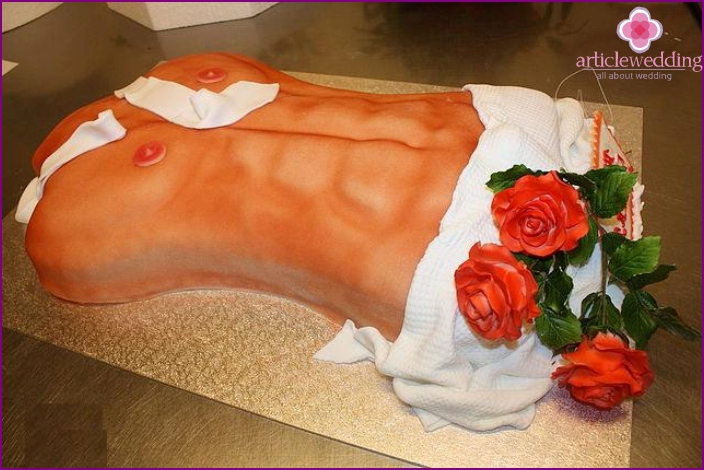 Cake in the form of a male torso for a bachelorette party