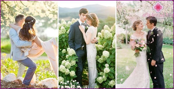 Photo newlyweds in a flowering garden