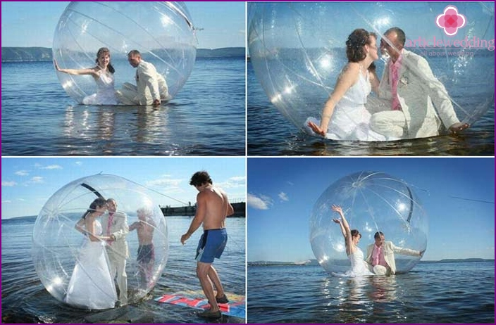 Photo session of the newlyweds in a transparent bowl