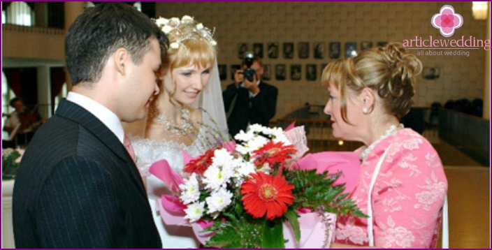 Mother of the groom congratulates couple