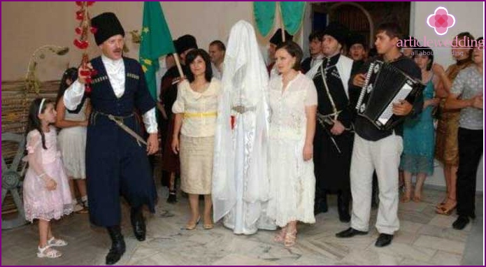 The bride enters into a new house with covered face