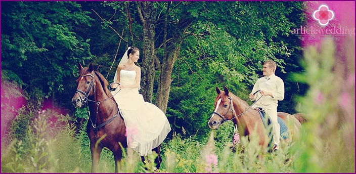 Horse riding bride and groom