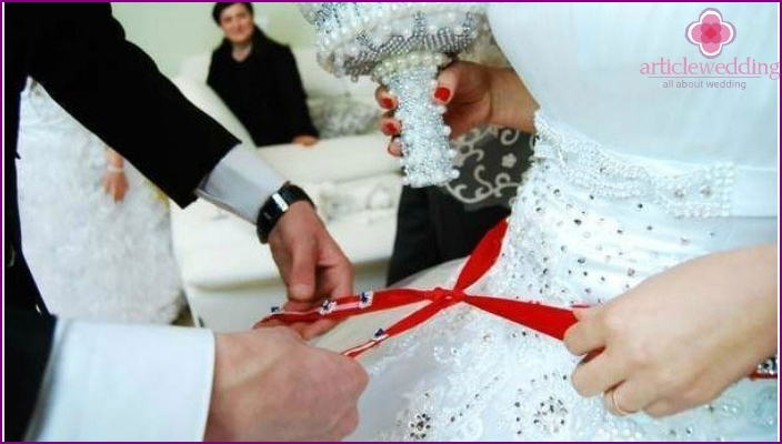 Tying a red ribbon Azerbaijani girl