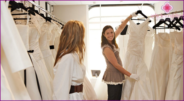 Trying on the bride's dress