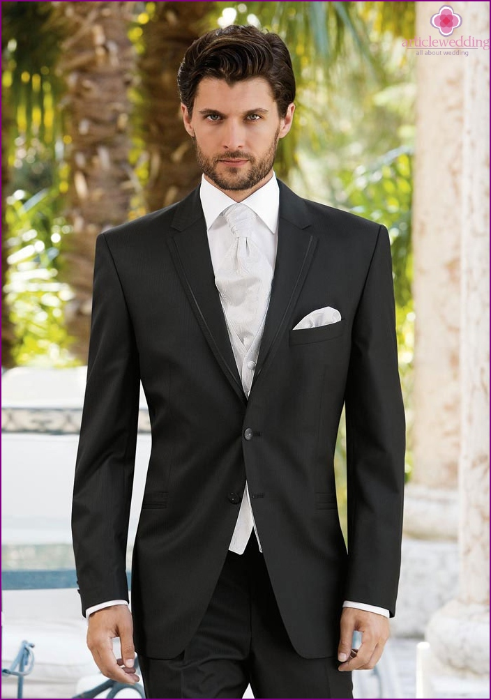 Strict dark suit for a man to a wedding