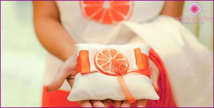 Rings on orange wedding