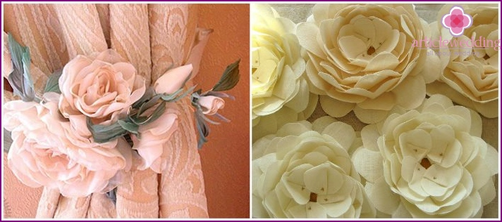 The decor of the wedding banquet hall with fabric flowers