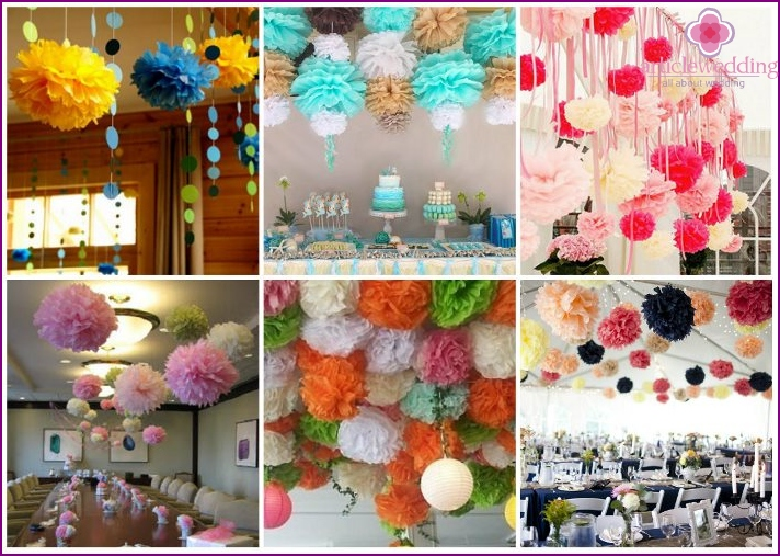 Paper pompoms on the ceiling will be the wedding decor