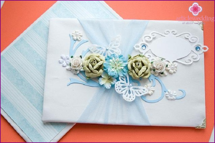 Flowers on a book of wedding wishes
