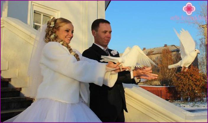 Bride releasing doves