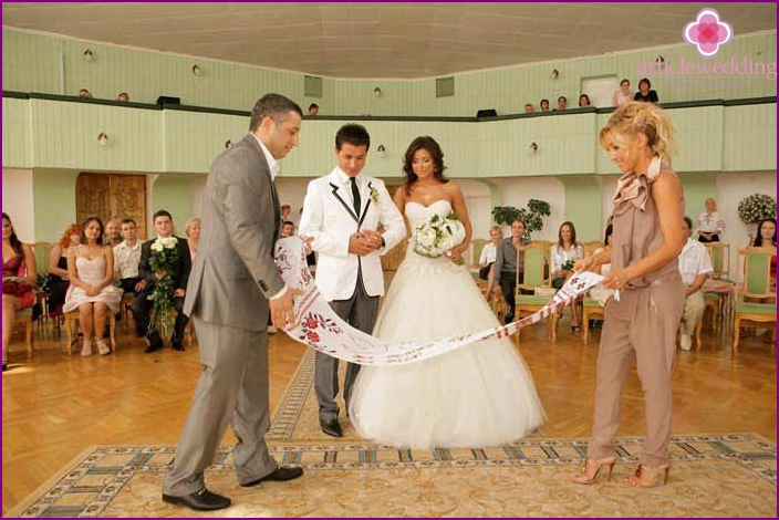 Witnesses spread a young wedding towel