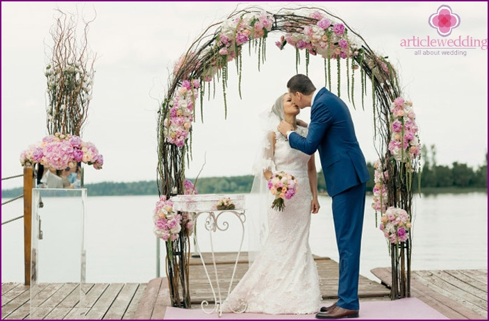 Arch with peonies on-site ceremony