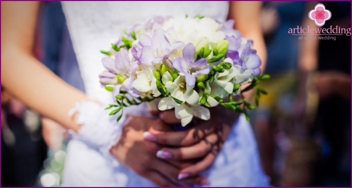 Wedding bouquet of white and purple flowers