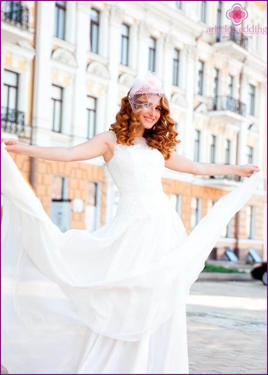 Bride with pink veil