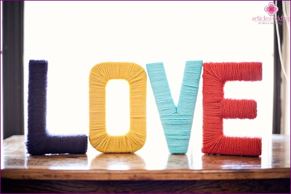 Letters of colored thread