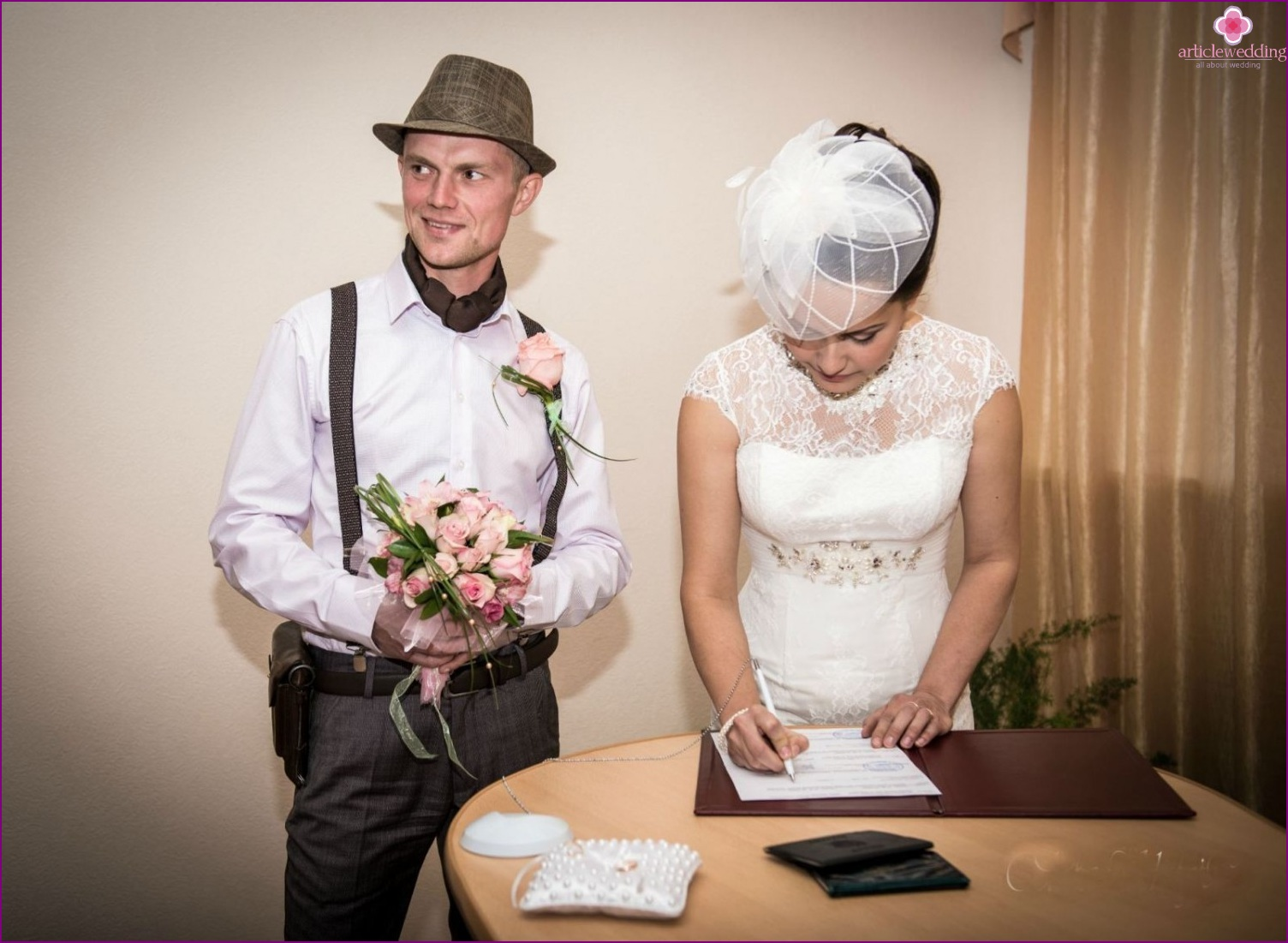 Suspenders and a hat in the image of the groom