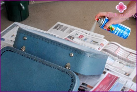 Coat the suitcase with spray paint