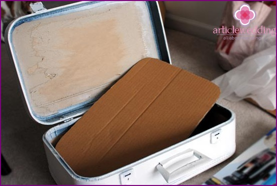 Cut a cardboard part for a suitcase