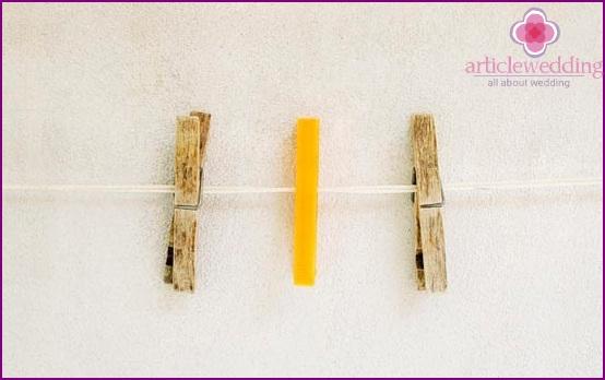 Fasten clothespins to threads