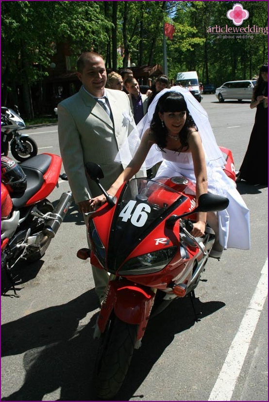 Happy married couple on a two-wheeled monster