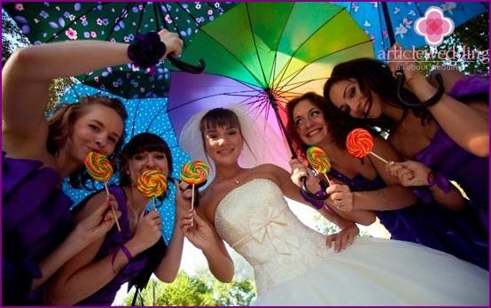 Wedding photo session with a multi-colored umbrella