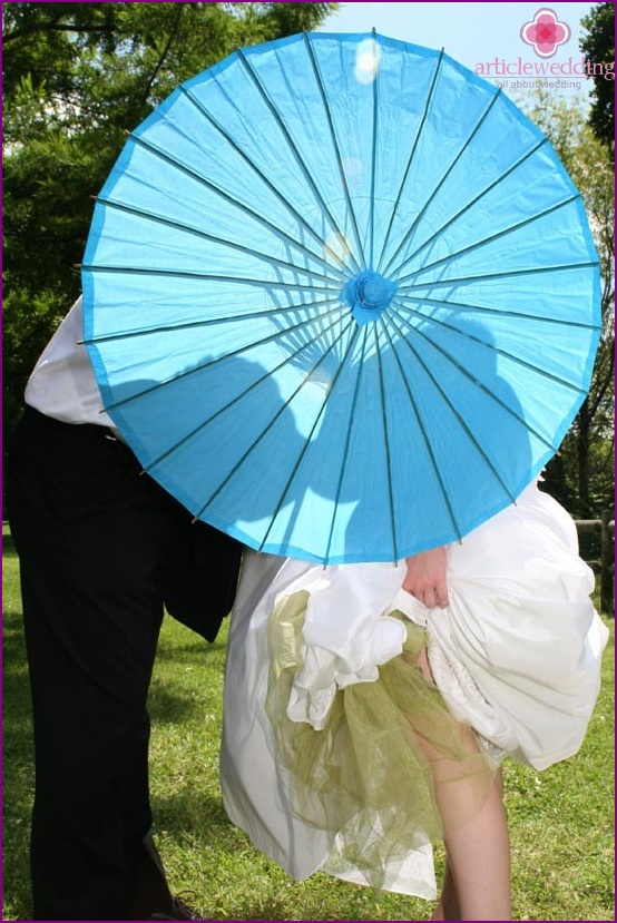 Silhouettes on the umbrella for wedding photography