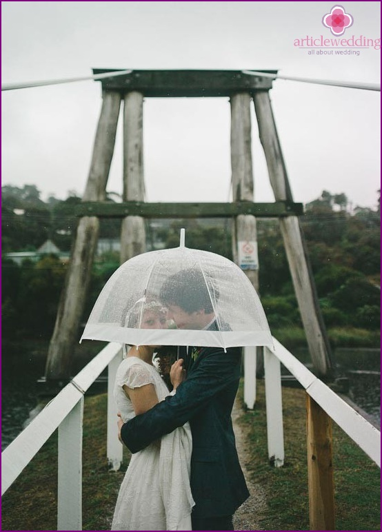 Transparent umbrella for a wedding photo shoot