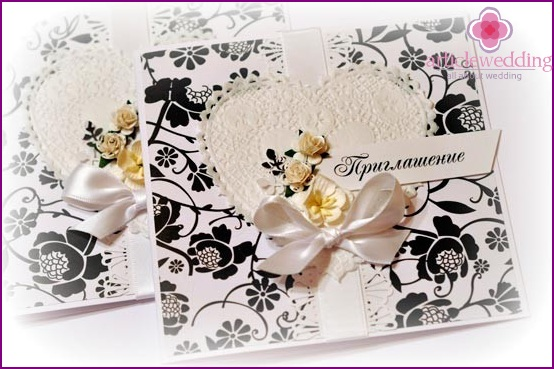 Invitation cards in black and white.