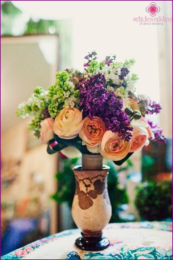 Flowers for decorating a wedding table in the style of the 90s