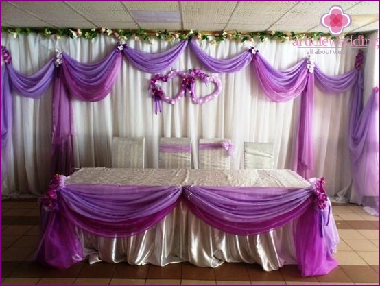 Decoration of the wedding hall in lilac color