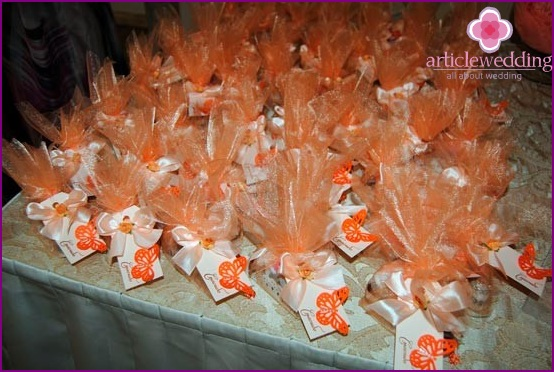 Wedding gifts for guests in peach-orange decoration