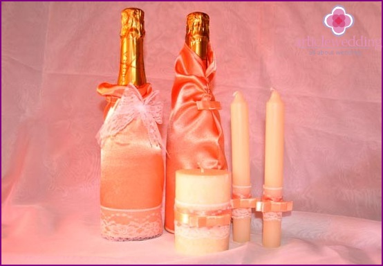 Decoration of candles and bottles for a wedding table