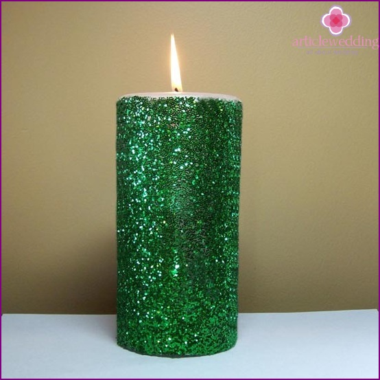 Emerald candle for a wedding