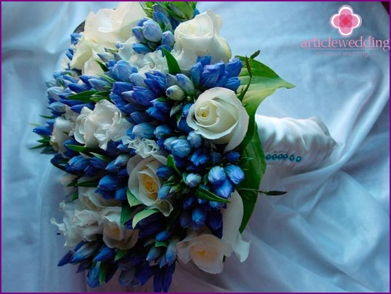 Bridal bouquet of white roses in addition with blue flowers
