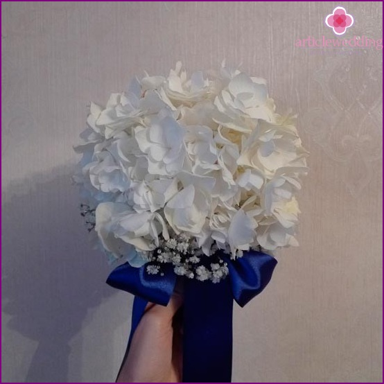 Bridal bouquet of white flowers with blue satin ribbon
