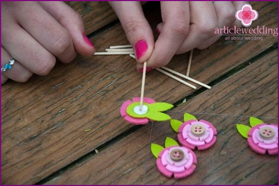 How to attach a toothpick to a flower