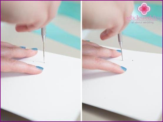 We make holes in the cardboard