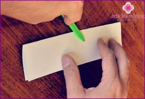 Bend the paper in half