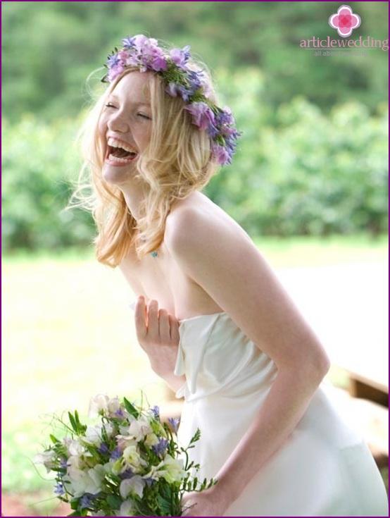 Bride in a wreath of fresh flowers