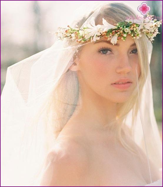 Bride in a wreath over a veil