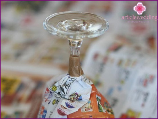 Wrap a glass with newspapers