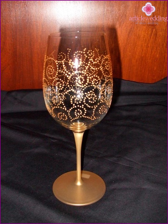 Glass decorated with golden paint